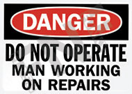 Danger – Do not operate – Man working on repairs