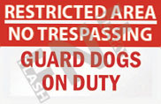 Restricted area – No trespassing – Guard dogs on duty