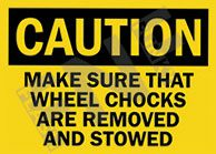 Caution – Make sure that wheel chocks are removed and stowed